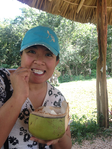 Amusing Maria eating a coconut