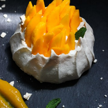 Mango Pavlova with Mango Rum Coulis
